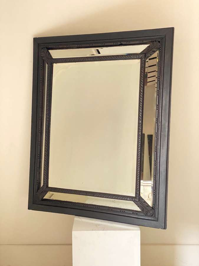 Circa 1850 A French Ebonized Cushion Mirror