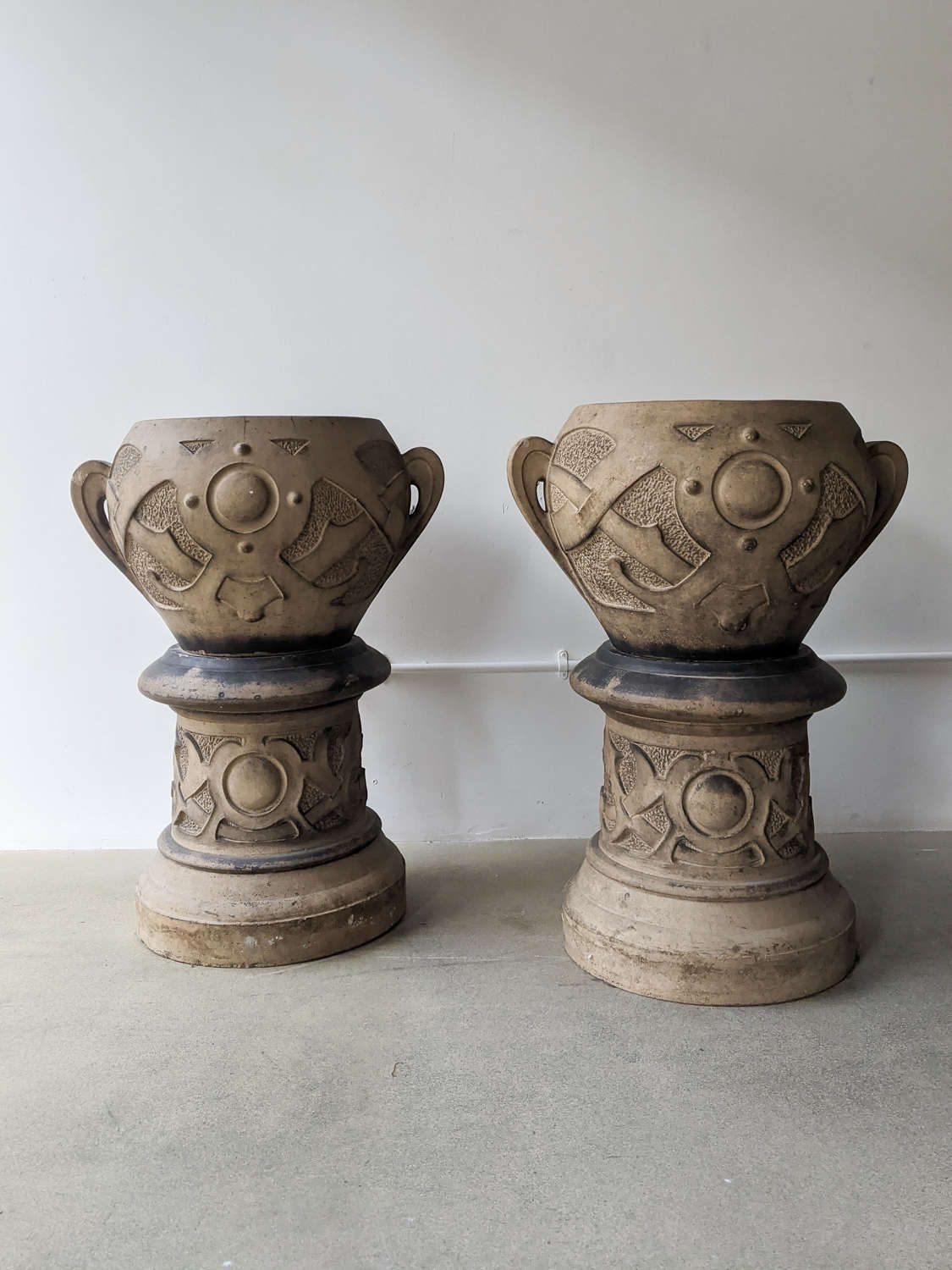 C1900 A Pair of Art Nouveau Urns on Stands.