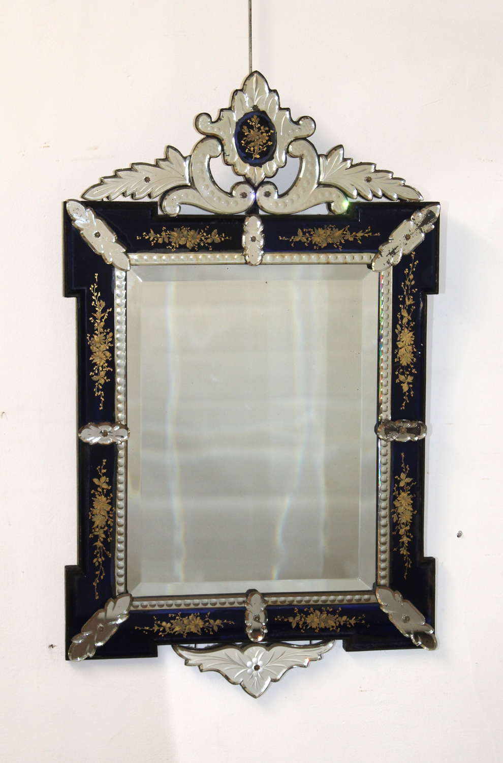 Antique decorative Venetian mirror with dark blue and gold frame