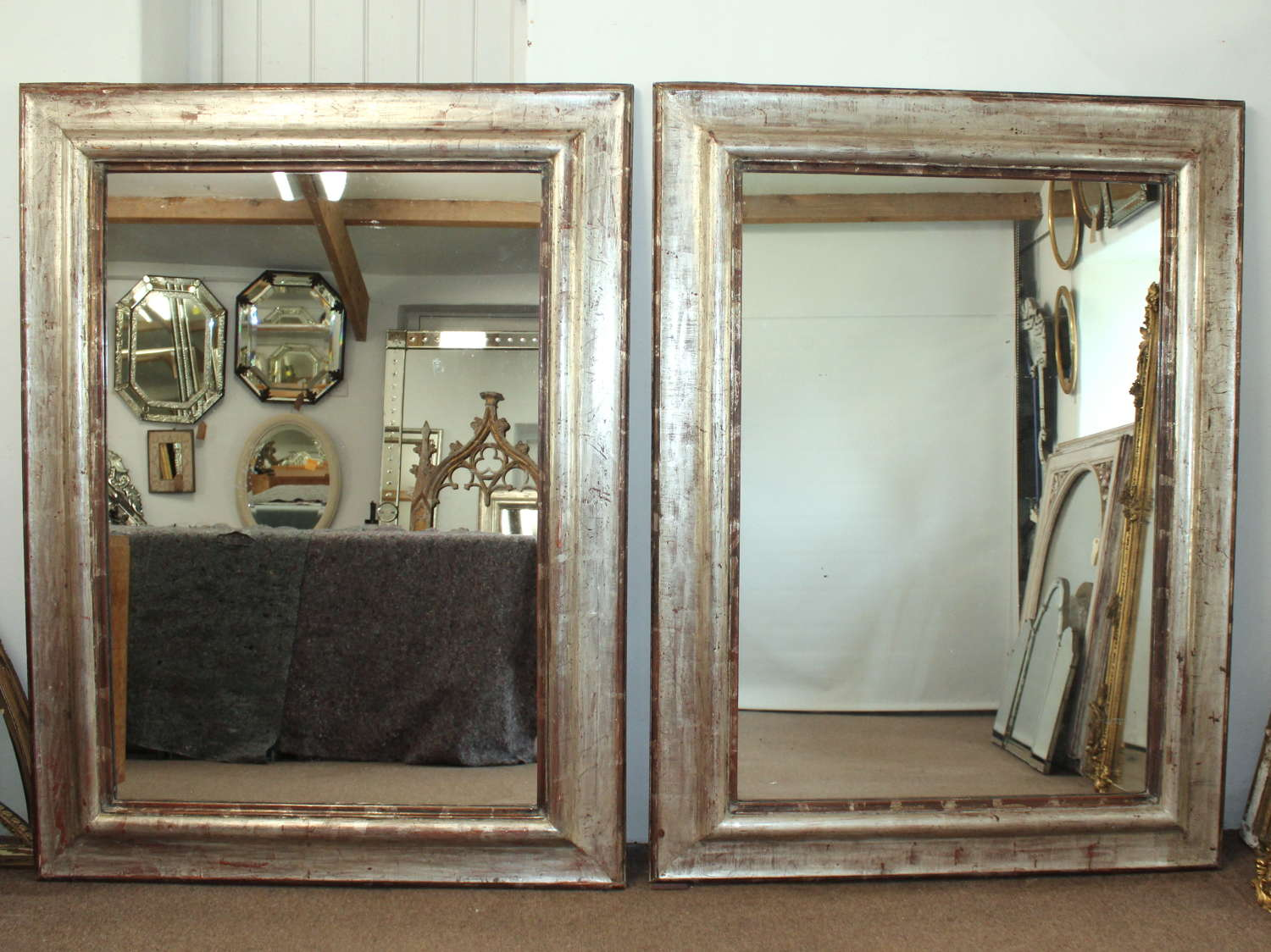 Pair of large architectural Italian silverleafed mirrors