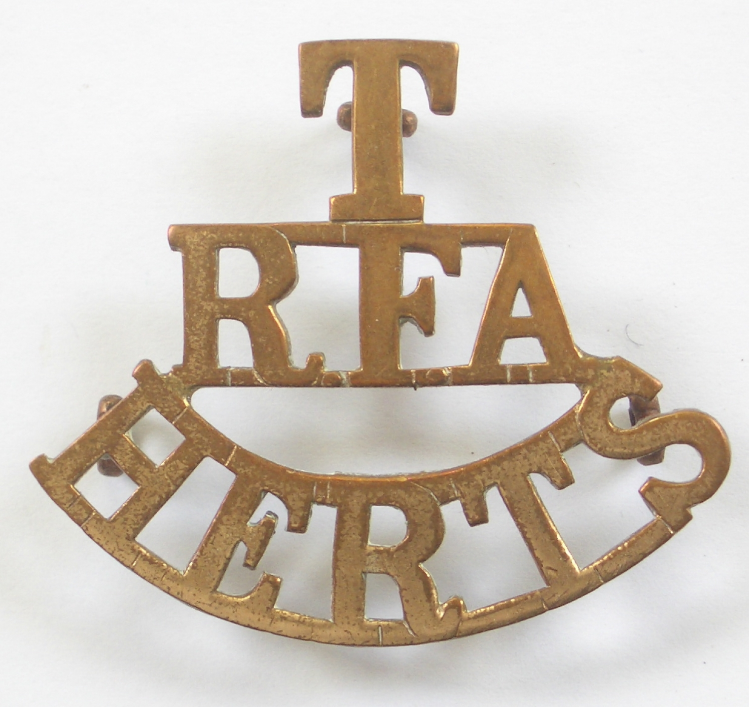 T/RFA/HERTS scarce brass shoulder title