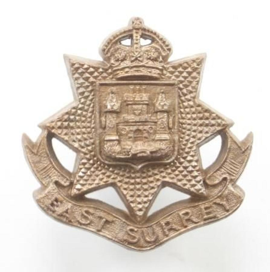East Surrey Regiment WW2 plastic economy cap badge.