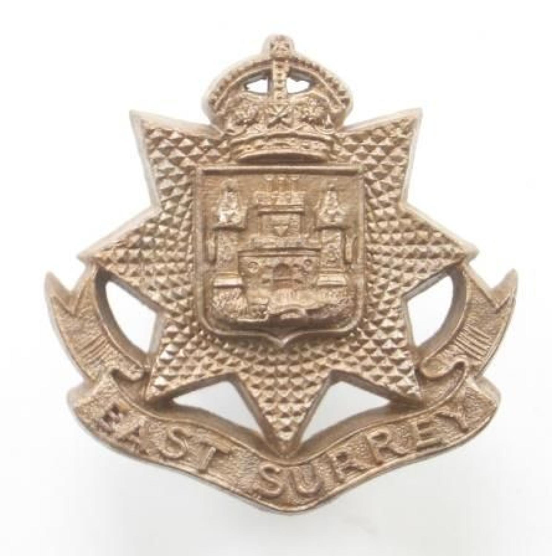 East Surrey Regiment WW2 plastic economy cap badge.