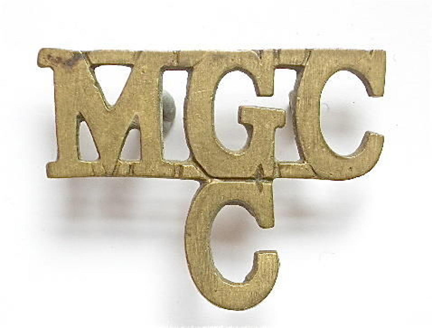 MGC / C scarce Machine Gun Corps, Cavalry WW1 brass shoulder title
