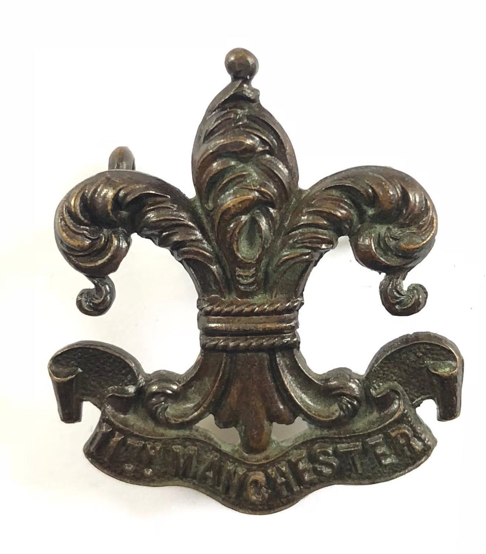 11th (Service) Bn. Manchester Regiment rare WW1 bronze cap badge.