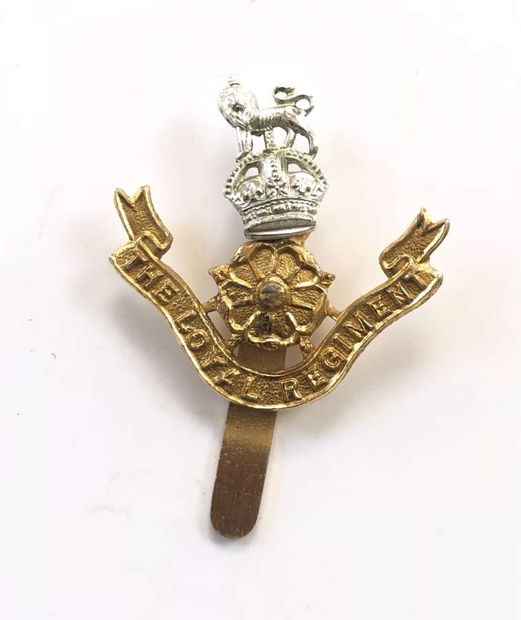 The Loyal Regiment King's Crown anodised cap badge.