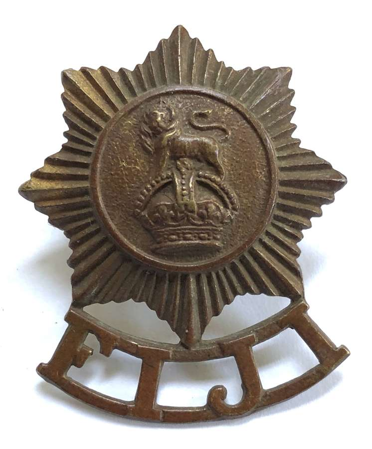 Fiji Defence Force brass cap badge with JR Gaunt, London