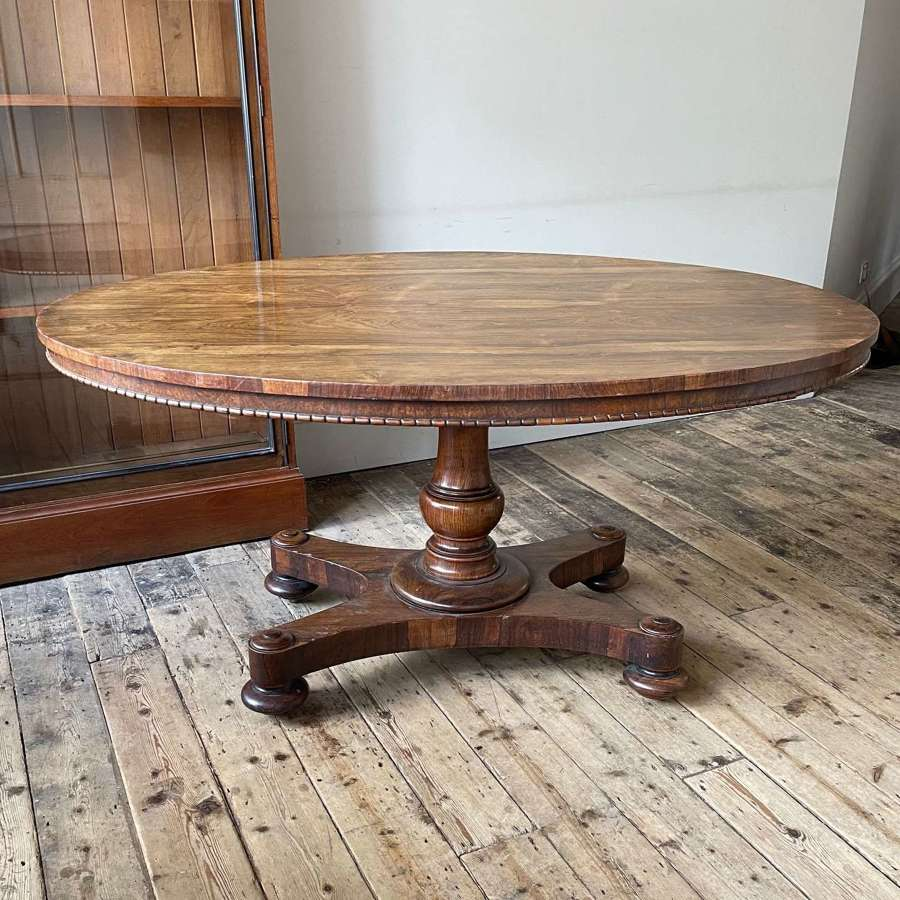 A rosewood centre table by Holland & Sons