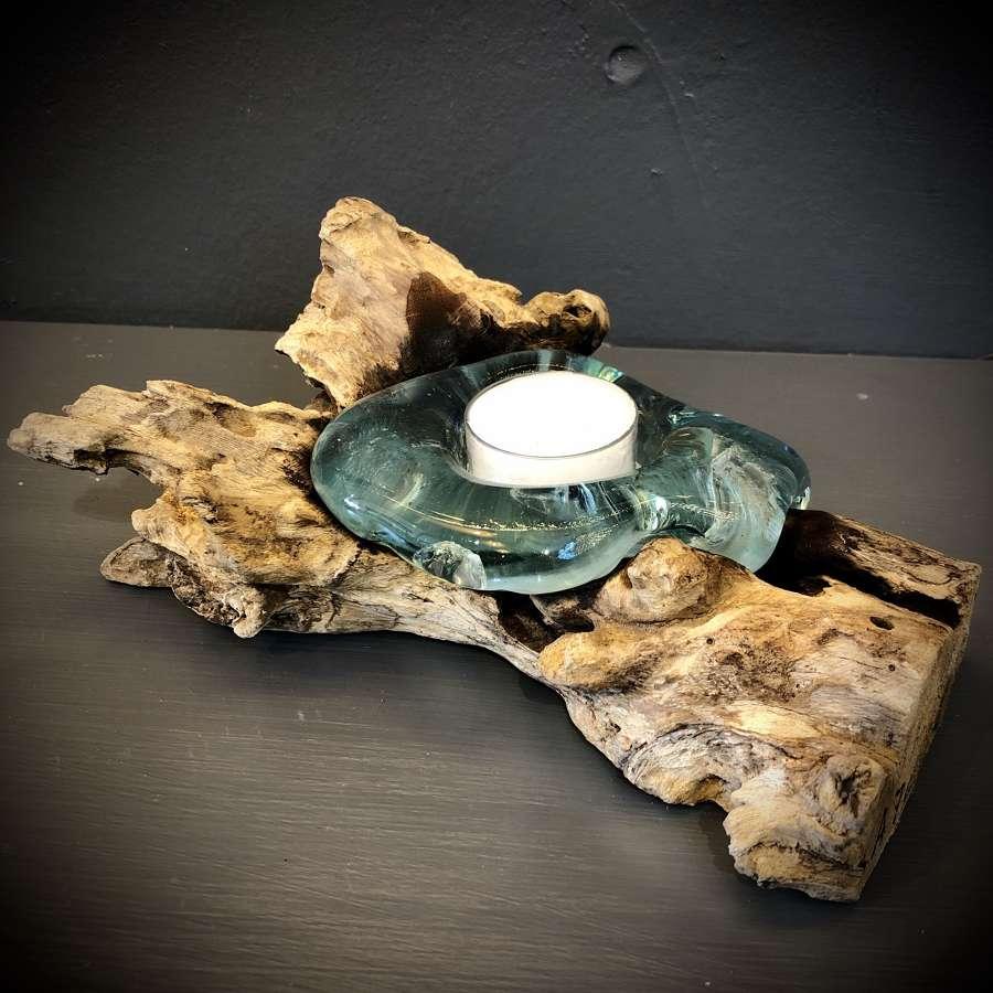Melted glass tea light holder